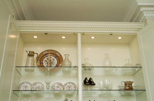 Overhead Lighting and Glass Display Shelves