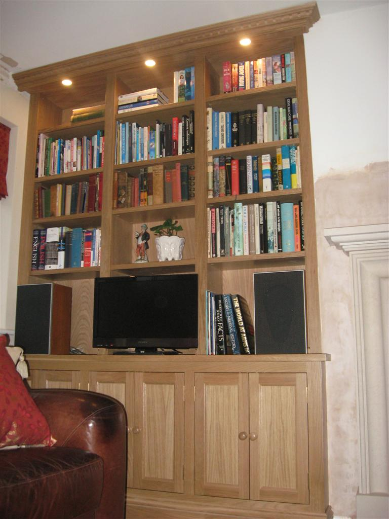 24) Oak fitted Alcove Bookcase
