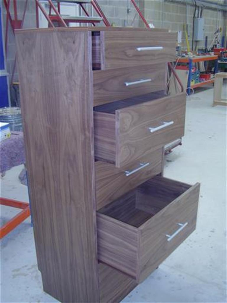 Dark wood tall chest of drawers